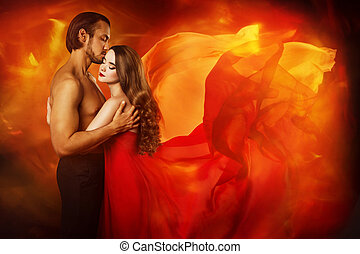 Couple Beauty Portrait, Kissing Man in Love and Seductive Dreaming Woman in Waving Fantasy Dress