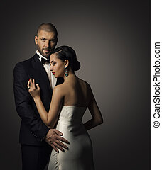 Couple Beauty Portrait, Well Dressed Handsome Man in Suit with Elegant Beautiful Woman in White Dress