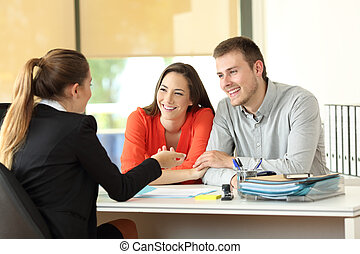 Couple being attended by office worker