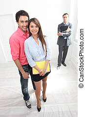 Couple being shown around property by estate agent