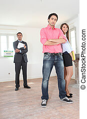Couple being shown around property