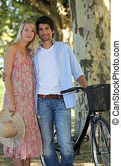 Couple biking on a summer's day
