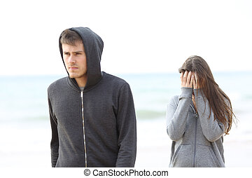 Couple break up on the beach with a man leaving girl