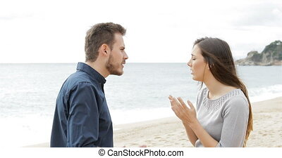 Couple breaking up on the beach