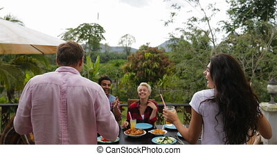 Couple Bring Juice People Passing Food Eating On Terrace Young Friends Talking Sitting At Table Communication
