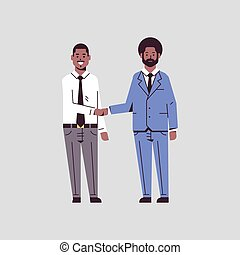couple businessmen handshaking business partners hand shake during meeting agreement partnership concept african american male colleagues in formal wear standing together flat full length