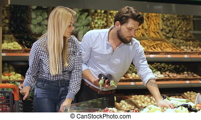 Couple buy eggplants at the mall