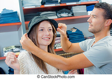 Couple buying a hat