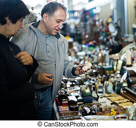 Couple buying antique things at the antique market