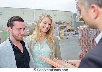 couple buying building materials