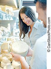 couple buying cheese