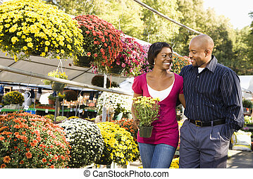 Couple buying flowers.