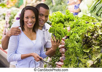 Couple buying fresh produce in supermarket
