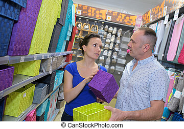 couple buying house ware in the shop