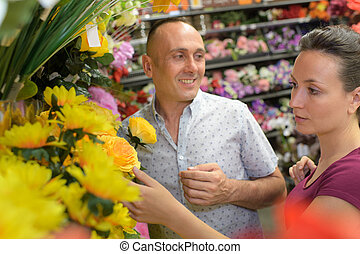 couple buying of artificial flowers
