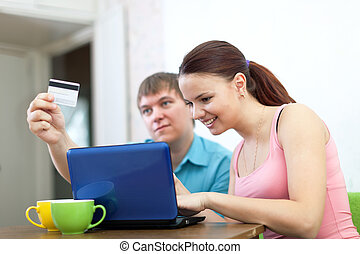 couple buying online with laptop