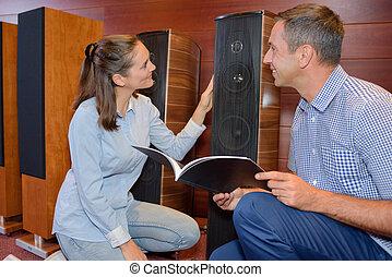 couple buying speakers
