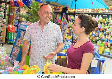 couple buying toys