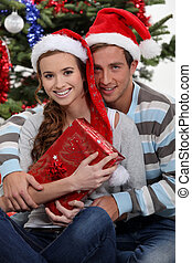 Couple by a Christmas tree