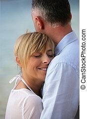 couple by seashore