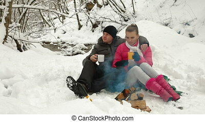 Couple By The Bonfire In Winter