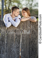 Couple by the fence