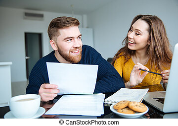 Couple calculating their bills at home