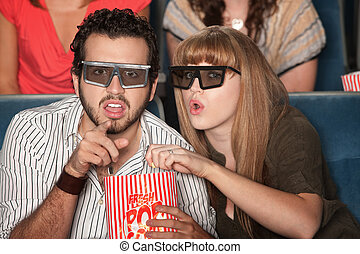 Couple Captivated by 3D Movie - Caucasian couple with 3D ...
