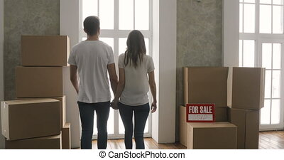 Couple Carrying Boxes Into New Home or new apartment On Moving Day