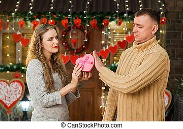 girl giving present to her boyfriend