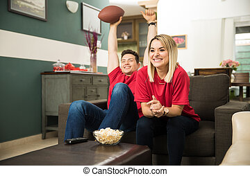Couple celebrating a touchdown