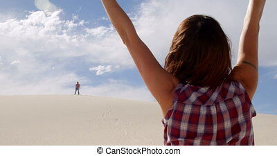 Couple celebrating after sand boarding 4k - Excited couple...