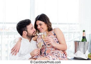 Couple celebrating weekend getaway in hotel.