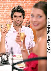 couple, champagne, restaurant