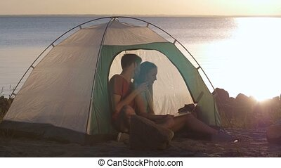 Couple chats online via skipe during camping trip - Joyful...