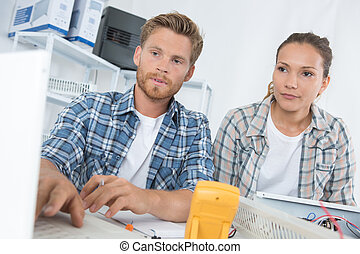 couple checking computer at home