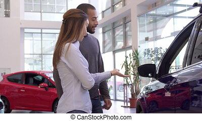 Couple chooses car at the dealership