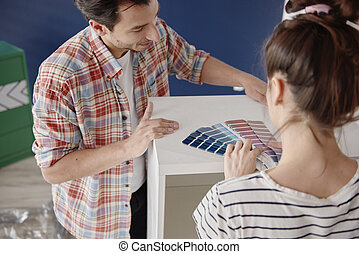 Couple choosing colors for new house