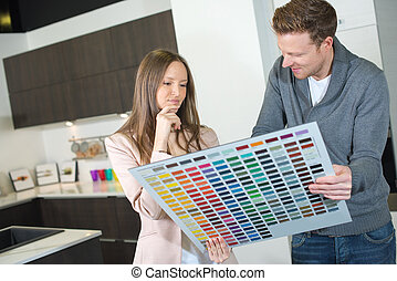 couple choosing colour of a kitchen