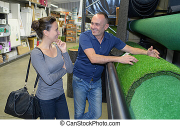 couple choosing grass in a store