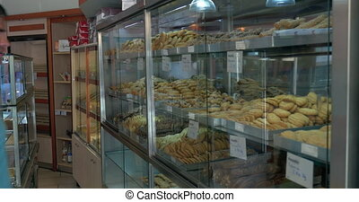 Couple choosing tasty cookies in the grocery