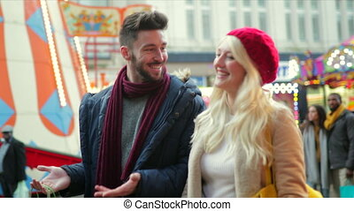 Couple Christmas Shopping - Tracking shot of a young couple...