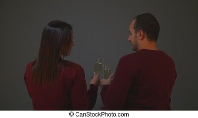 couple clinking with champagne glasses and celebrating new year