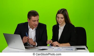Couple colleagues decide a strategy for further action. Green screen