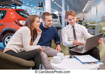 Couple communicating with the salesman in showroom - Your...