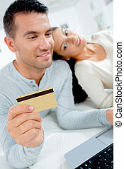 couple computer and bank card