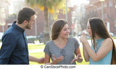 Couple congratulating a friend in the street - Happy couple...