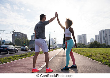 couple congratulating on morning run ginis young sporty ...