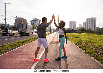 couple congratulating on morning run ginis young sporty...