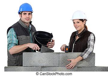 couple, construire, mur